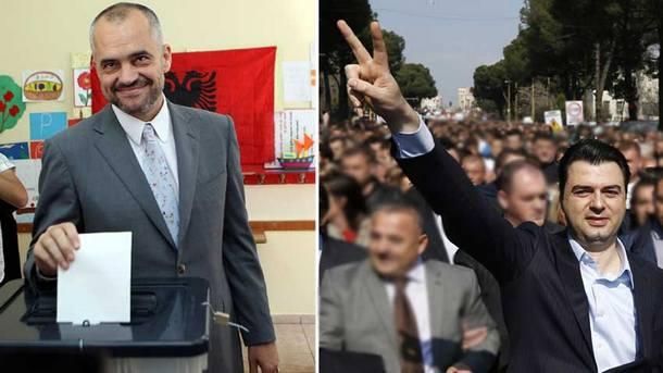 Премиерът Еди Рама (в ляво) и опозиционният лидер Люлзил Баша.