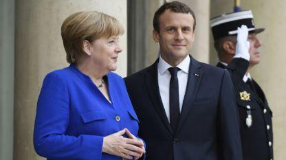 Френският президент Еманюел Макрон и германския канцлер Ангела Меркел.
