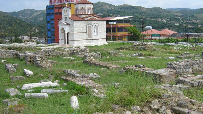 Руините на средновековния манастирски център в Балш. На заден план е новата църква, дарение от Симеон Сакскобургготски.