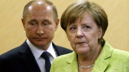 Владимир Путин и Ангела Меркел на една от срещите им.