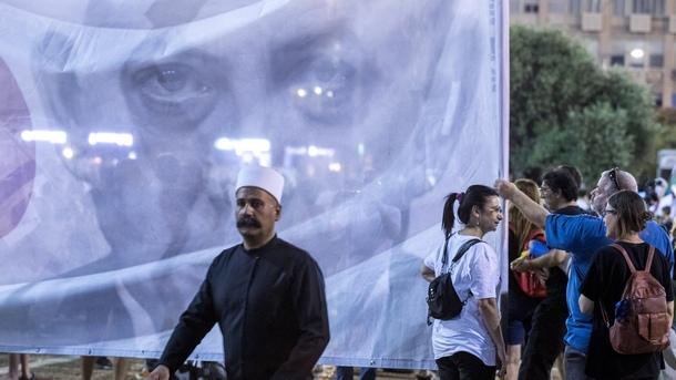 Израелският премиер Бенямин Нетаняху е видим на протестен плакат в демонстрация в подкрепа на малцинството друзе