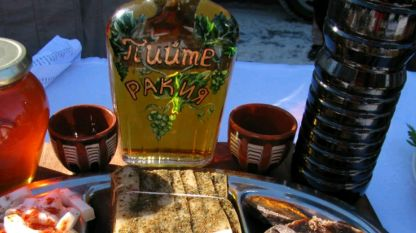 """Drink rakiya brandy"" reads the inscription on the bottle"