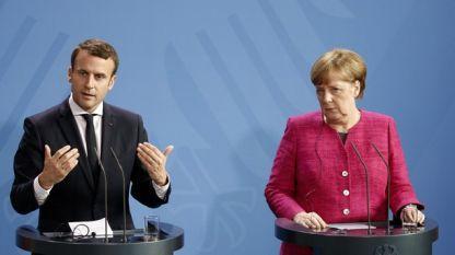 Еманюел Макрон и Ангела Меркел на пресконференция след една от срещите им.