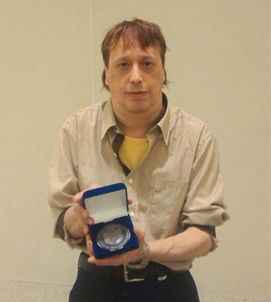 Mikhail Krastanov with medal from Ministry of Education, for contribution og Bulgarian School in Sao Paulo for promoting Bulgarian language, folklore and traditions