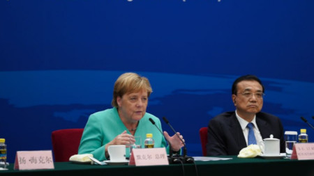 Ангела Меркел и Ли Къцян