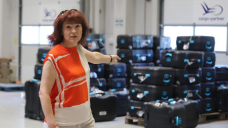 CEC spokesperson Rositsa Mateva in front of the voting machines dispatched abroad