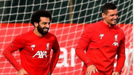 Салах (вляво) и Ловрен тренират с настроение на базата на Ливърпул.