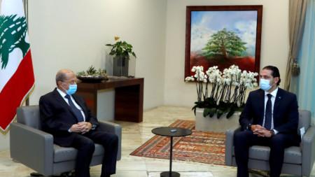 Президентът на Ливан Мишел Аун (вляво) и министър-председателят в оставка Саад Харири по време на разговора им в президентския дворец в Бейрут - 19 март 2021