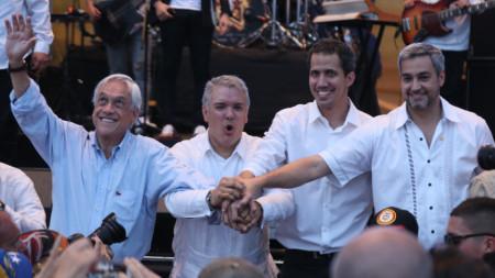 Чилийският президент Себастиан Пинера, колумбийският му колега Иван Дуке, венецуелският лидер Хуан Гуайдо и президентът на Парагвай Марио Абдо (от ляво на дясно) на концерта в Кукута.