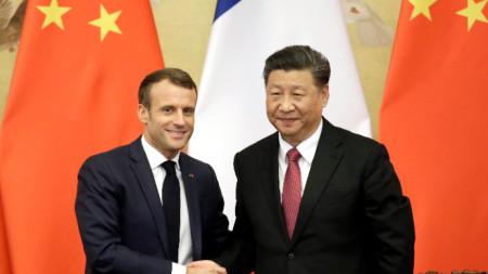 Еманюел Макрон и Си Цзинпин по време на визита на френския президент в Китай