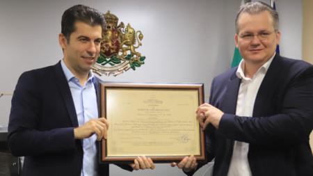 Kiril Petkov, caretaker economy minister (left)