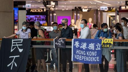 Активисти протестират срещу приемането на закона - Хонконг, 30 юни 2020
