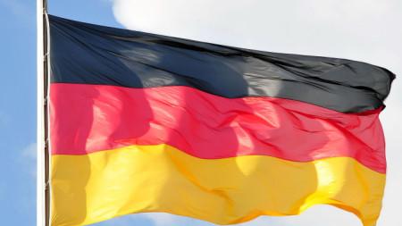 Развято национално знаме на Германия.