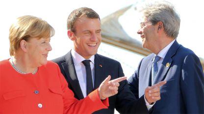 Германският канцлер Ангела Меркел, президентът на Франция Еманюел Макрон и италианският премиер Паоло Джентилони по време на срещата.