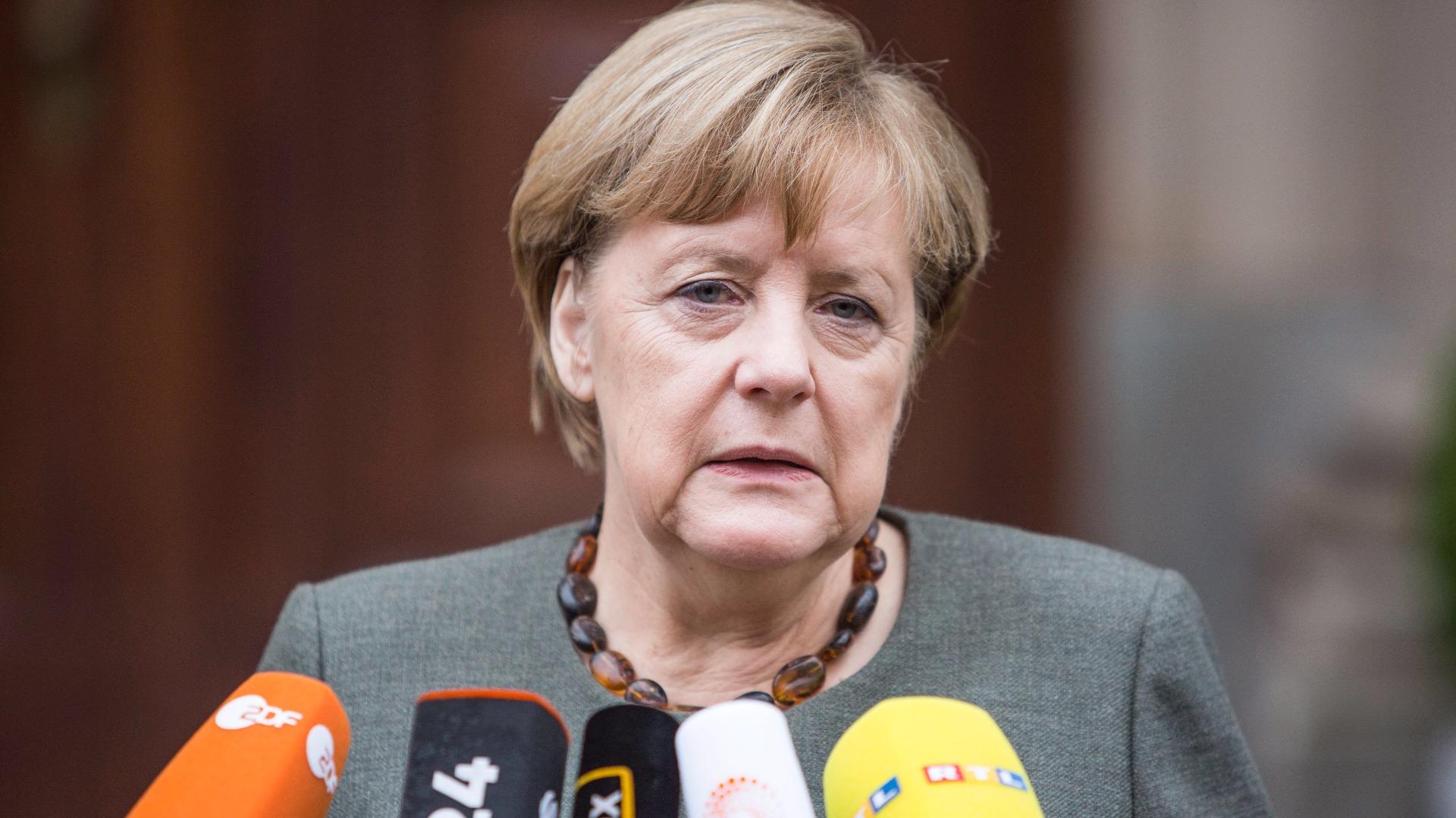 Ангела Меркел пред медиите в Берлин преди началото на разговорите.