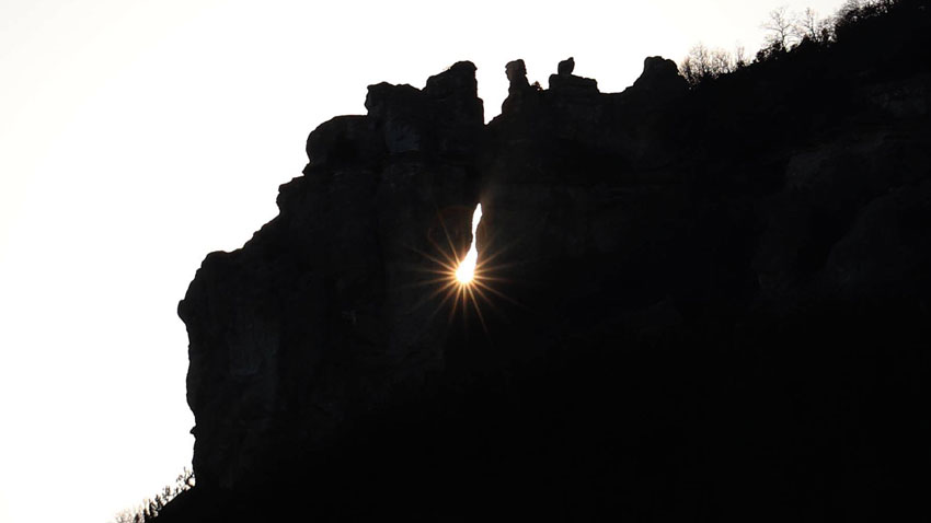 The ray of sunlight passing through the rock window