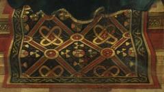 Фрагмент от картина на холандския художник Петрус Кристос от 1457 г. с реалистично изображение на тъкан ориенталски килим..