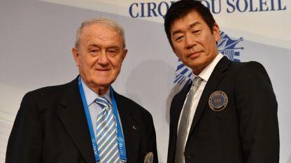 Новият президент на FIG Моринари Ватанабе и старият Бруно Гранди